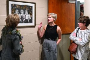 the artist discussing her artwork with two women